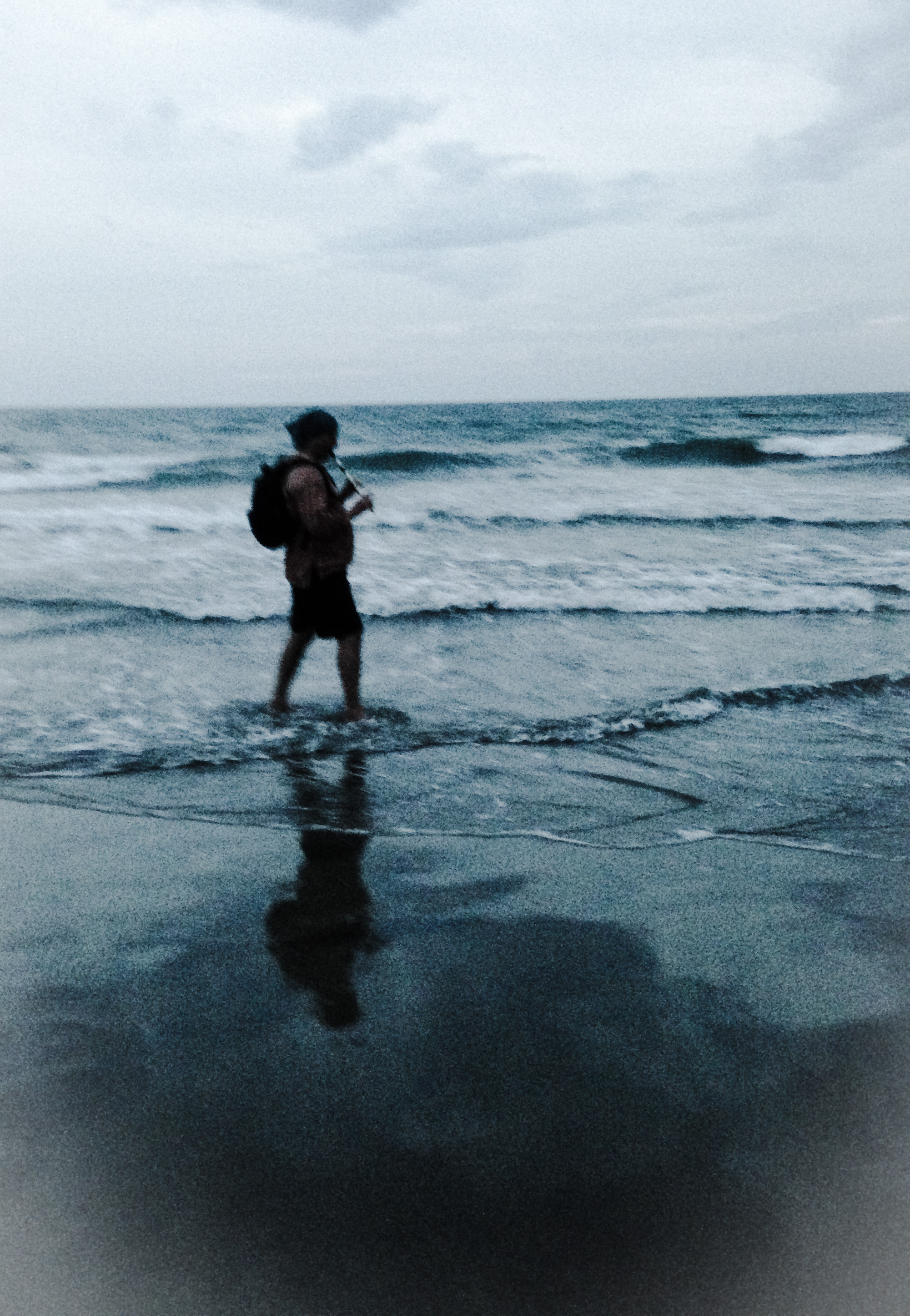 man playing flute in sea